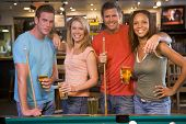 stock photo of portrait middle-aged man  - Friends at a pool hall - JPG