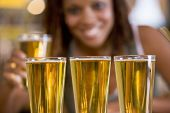 pic of bing  - Woman posing with several beer glasses - JPG