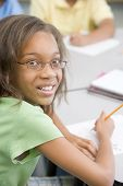 picture of tweeny  - Student in class writing  - JPG