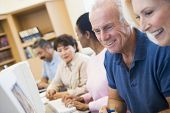 picture of senior-citizen  - Five people at computer terminals in library  - JPG