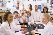 stock photo of hair integrations  - Students in biology class with teacher - JPG