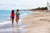 VARADERO,CUBA-NOVEMBER 3:Foreign tourists walking at the beach November 3,2012 in Varadero.With 50 h