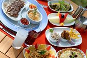 image of ouzo  - Rich and delicious Turkish dinner table with tapas - JPG