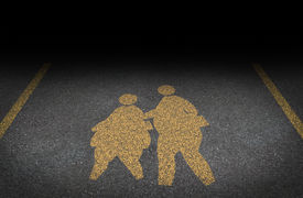 image of obese children  - Obesity in children and childhood obese concept with a yellow painted asphalt road sign showing an icon of overweight kids and young students as a warning to the hazards of eating junk food and fatty fast food - JPG