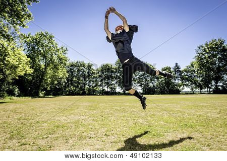 Jumping American Football Player