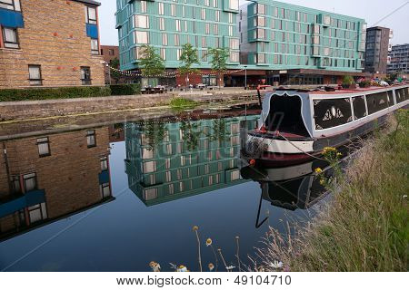 Canal boat moored in calm water.