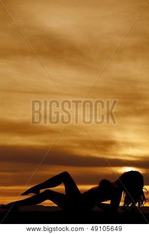 Woman Silhouette Lay Back One Leg On Other Swimsuit