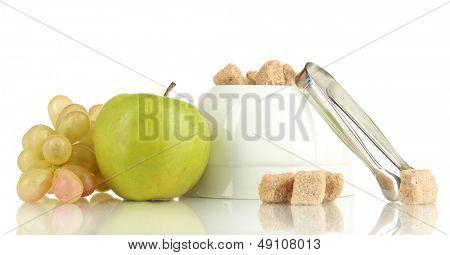 Unrefined sugar in white sugar bowl on white background