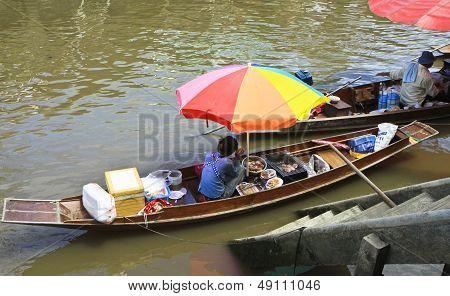 Seller In Rowboat at Amphawa