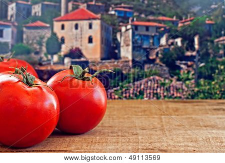 Red Ripe Tomatoes On Rustic Wooden Table
