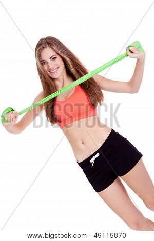 Athletic Young Woman Doing Workout With Physio Latex band