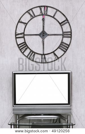 Wall Clock Under Blank White Screen Of Tv Set