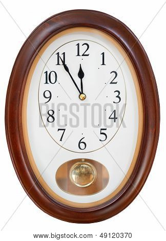 At Five Minutes To Twelve On Wall Clock