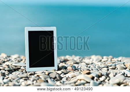 Concept Of Internet And Communication. Blank Tablet Computer On The Beach