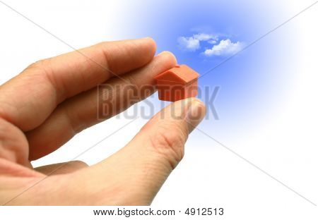 Small House In Hand With Sky