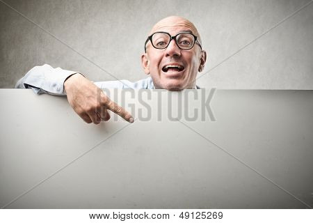 bald businessman pointing on billboard