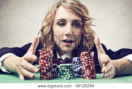 woman at the casino with many fiches