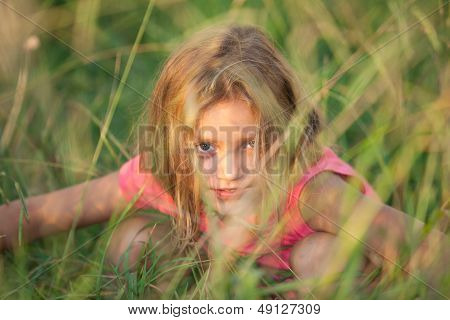 girl hiding in the high grass