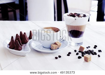 coffee and delicious chocolates on the table