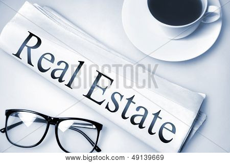 Real Estate word on newspaper