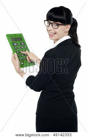 Bespectacled Woman Turning Back, Holding Calculator