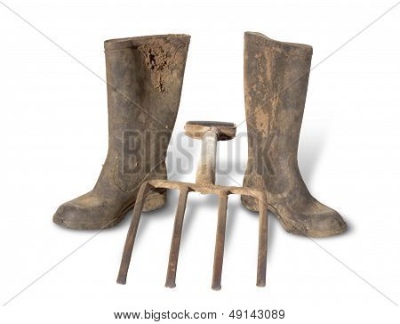 Dirty Boots And Gardening Fork