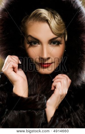 Beautiful Woman In Winter Fur Coat. Retro Portrait