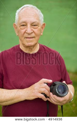 Senior Man With Digital Camera