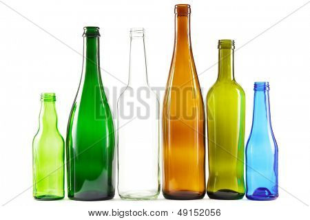 Glass bottles of mixed colors including green, clear white, brown and blue