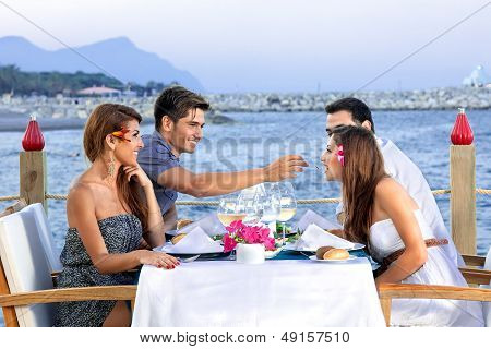 Two Couples Celebrating At The Sea