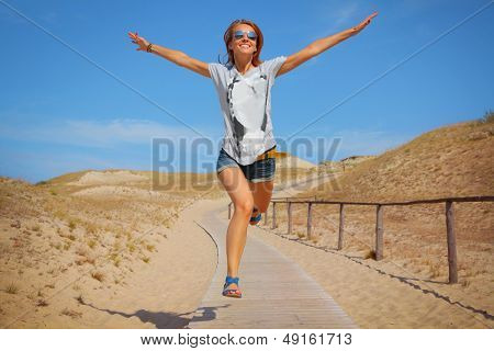happy young woman jumping outdoors