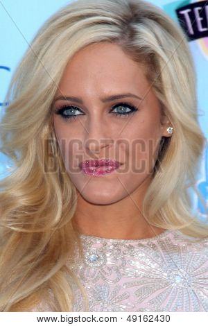 LOS ANGELES - AUG 11:  Carly Chaikin at the 2013 Teen Choice Awards at the Gibson Ampitheater Universal on August 11, 2013 in Los Angeles, CA