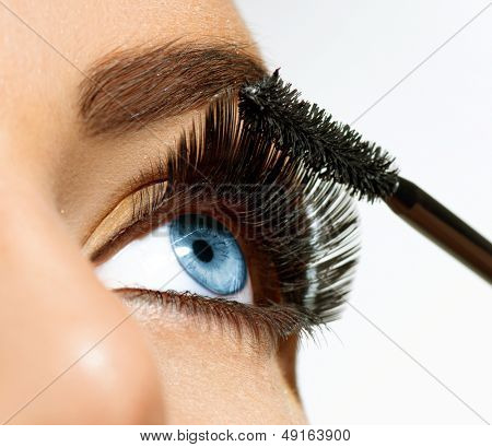 Mascara Applying. Long Lashes closeup. Mascara Brush. Eyelashes extensions. Makeup for Blue Eyes. Eye Make up Apply