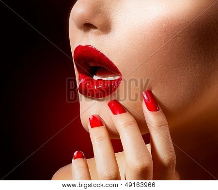 Red Lips and Nails. Red Lipstick and Nail Polish. Make up and Manicure. Makeup closeup