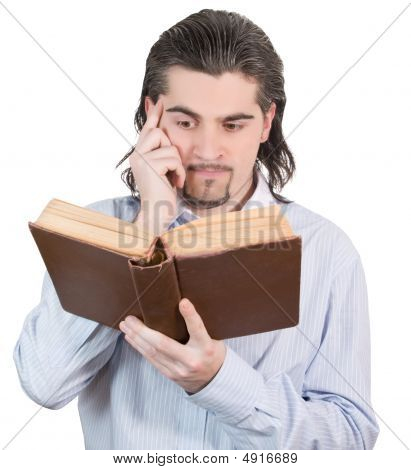 Young Handsome Guy Looks Into Big Book And Thinks Isolated White