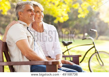 beautiful elegant mid age couple daydreaming retirement outdoors