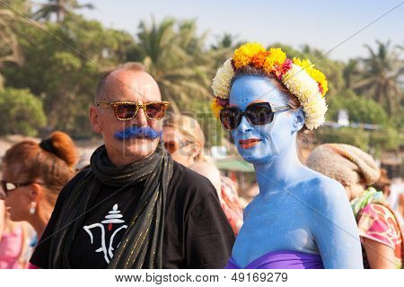 Unidentified Woman With Blue Skin And A Man With A Blue Mustache At