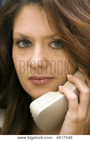 Woman On Phone With Concerned Expression