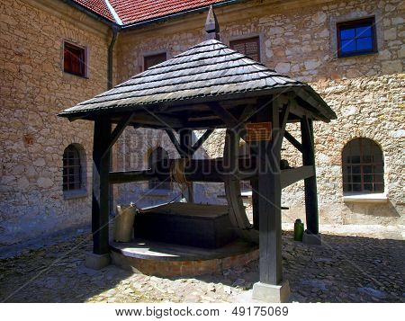 Old Well In The Shrine Of The Annunciation, In The Monastery Of Reformers In Kazimierz Dolny