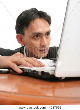 Portrait Of Man Watching Computer On The Table