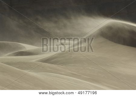 Sand blowing over sand dune in wind