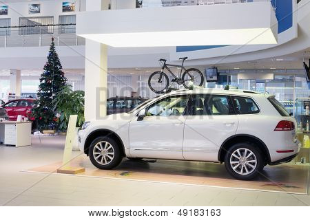 MOSCOW - JAN 11: Hall with cars and the Christmas tree in Volkswagen Varshavka Center on January 11, 2013, Moscow, Russia. Center offers a full range of cars Volkswagen
