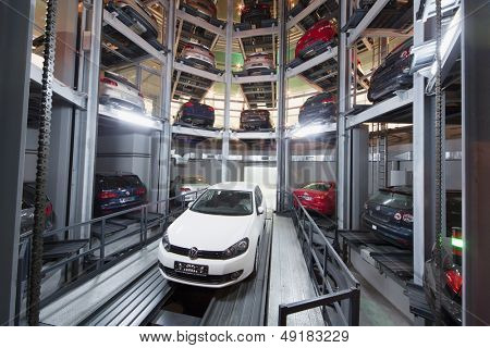 MOSCOW - JAN 11: The Volkswagen Golf on lift in premises for storage cars in Volkswagen Center Varshavka at night on January 11, 2013, Moscow, Russia. The tower was designed and built in 2009