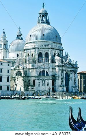VENICE, ITALY - APRIL 13: Santa Maria della Salute in the Grand Canal on April 13, 2013 in Venice, Italy. This main canal is 3800 meter long, 30-90 meters wide, with an average depth of 5 meters