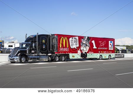 LOMG POND, PA - AUG 04, 2013:  The McDonalds hauler leaves the GoBowling.com 400 race at the Pocono Raceway in Long Pond, PA on Aug 4, 2013.