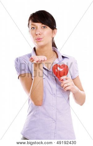 Happy woman with red heart symbol  and sent an air kiss isolated on white background