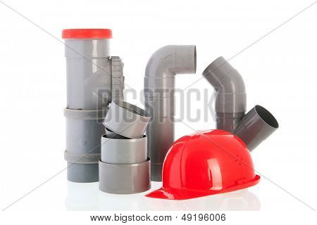 PVC tubes and pipes with red safety helmet