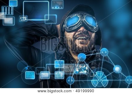 Steampunk concept, happy pilot vintage with big glasses, posing, electronic console