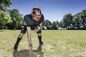 stock photo of lineman  - American football player offensive Lineman in in action at three point stance - JPG