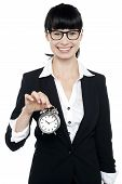 image of time-piece  - Smiling young lady showing an old fashioned time piece to the camera - JPG